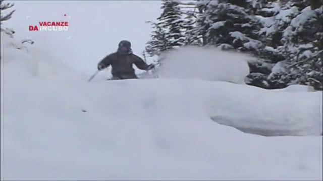 Un appassionato di snowboard e il suo cane