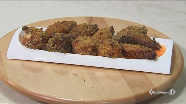 Alette di pollo panate su letto di crema ai peperoni